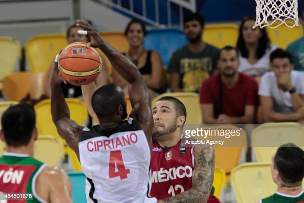 Olimpio Cipriano of Angola in action against Hector Hernandez of Mexico during the 2014 FIBA Basketball World Cup Group D match between Angola and...