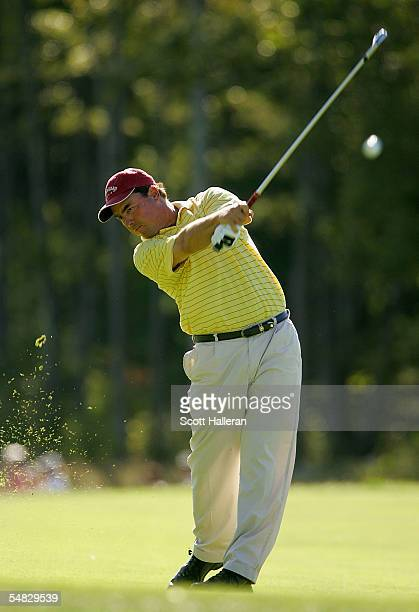 Olin Browne hits his approach shot on the 13th hole during the final round of the Deutsche Bank Championship at the TPC of Boston on September 5,...