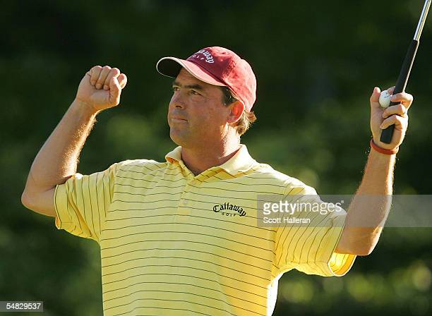 Olin Browne waves to the gallery on the 18th green after finishing with a 4-under par 67 during the final round of the Deutsche Bank Championship at...