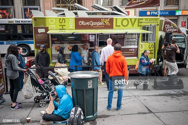 Olive Garden fans and the curious line up at the Olive Garden truck outside of Penn Station in New York to sample the casual dining restaurant's new...