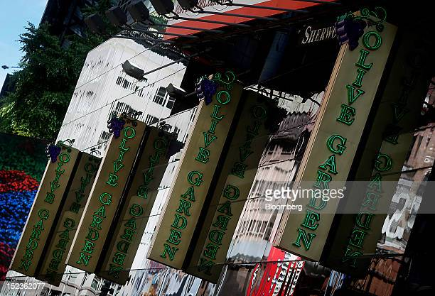 Olive Garden signage is displayed outside of a restaurant location in New York US on Wednesday Sept 19 2012 Darden Restaurants Inc operators of...