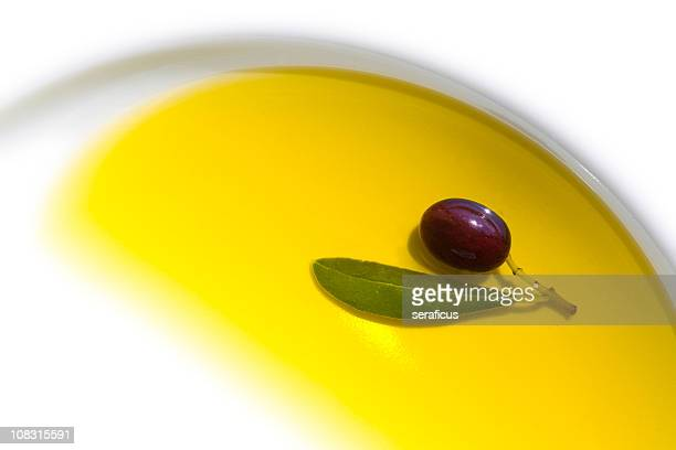 olive in oil - olive oil stock pictures, royalty-free photos & images