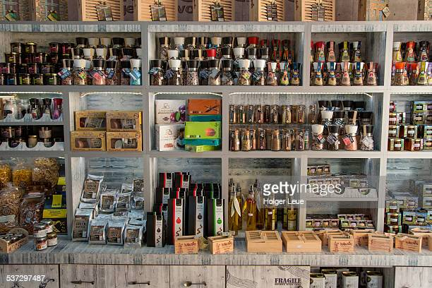 olive oil and delicatessen at souvenir shop - herakleion stock photos and pictures