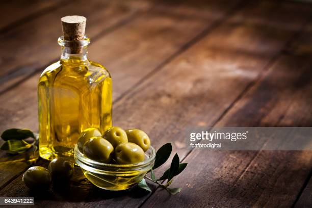 Olive oil and green olives. Copy space.