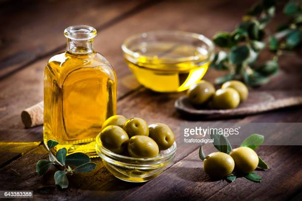 olive oil and green olives - green olive stock photos and pictures