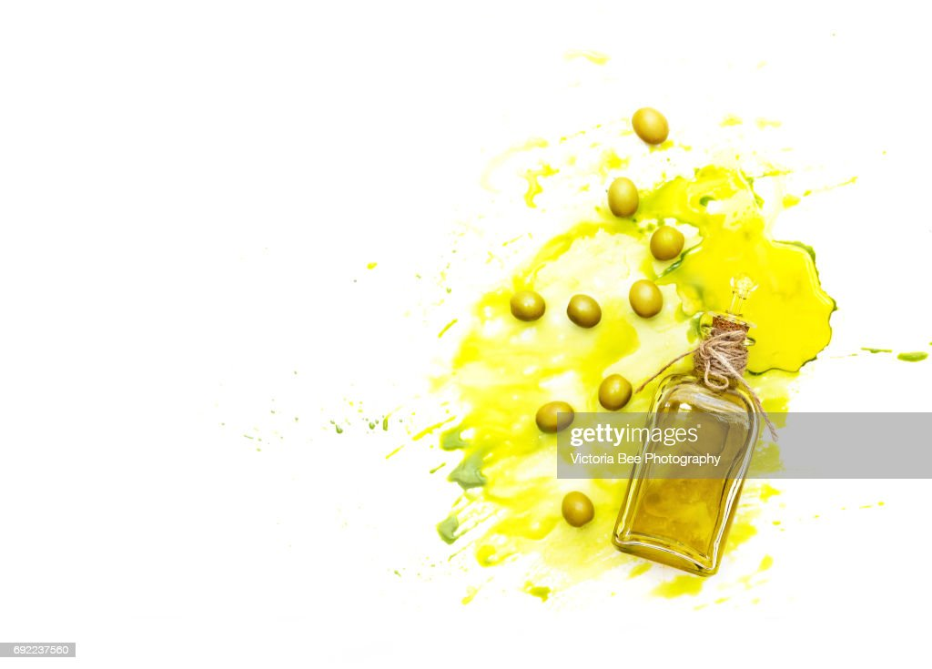 Olive oil and green olives shot from above. Creative food shot with watercolor. : Stock Photo