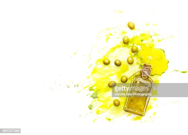 olive oil and green olives shot from above. creative food shot with watercolor. - aceitunas fotografías e imágenes de stock