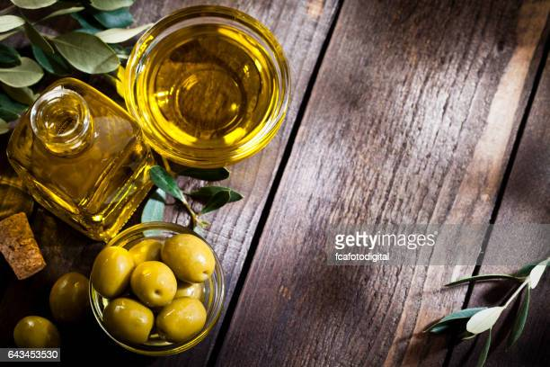 Olive oil and green olives shot from above with copy space