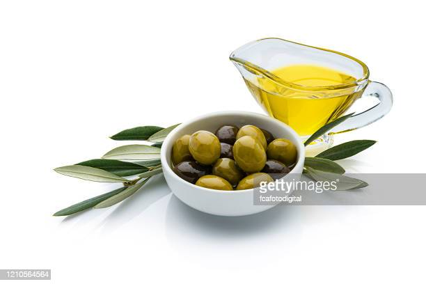 olive oil and olives isolated on reflective white background - extra virgin olive oil stock pictures, royalty-free photos & images