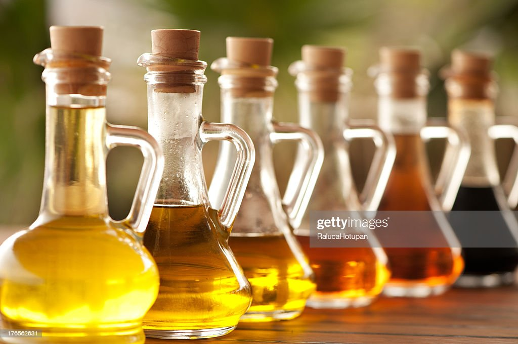 Olive oil and vinegar in bottles on the table : Stock Photo