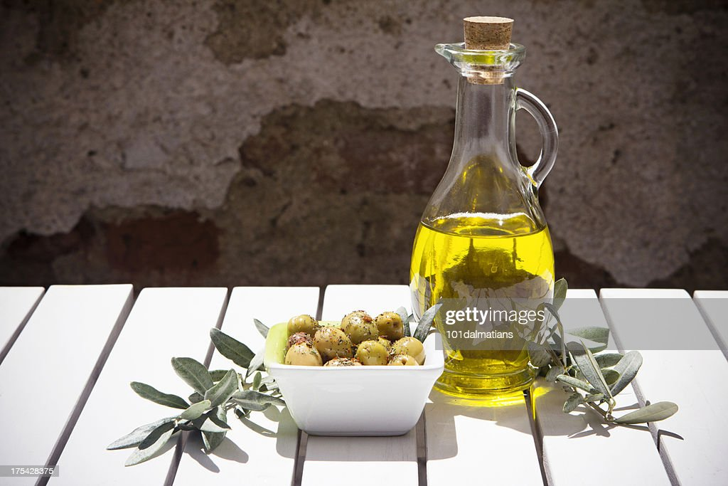 Olive oil bottle and branch : Stock Photo
