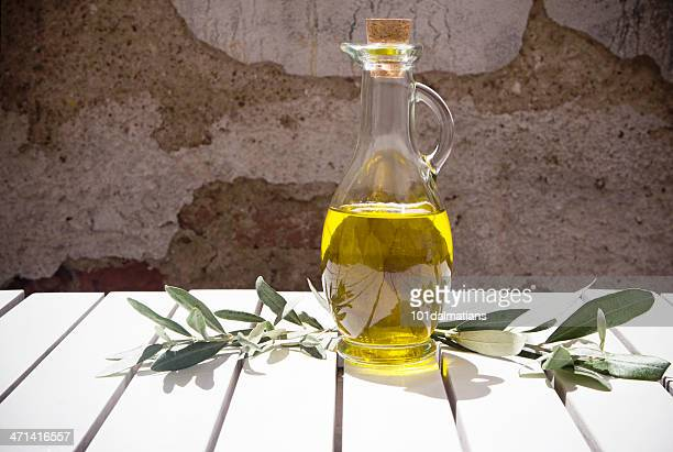 olive oil bottle and branch - luques olive stock pictures, royalty-free photos & images