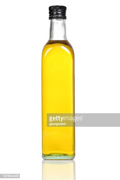 olive oil bottle close-up - olive oil stock pictures, royalty-free photos & images