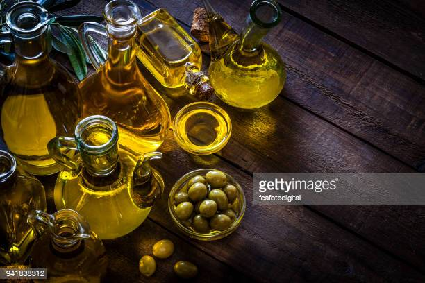 olive oil bottles - oil stock pictures, royalty-free photos & images