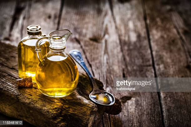 olive oil bottles still life with copy space - extra virgin olive oil stock pictures, royalty-free photos & images