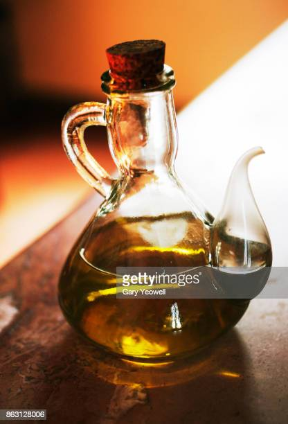 olive oil in a bottle - yeowell stock pictures, royalty-free photos & images