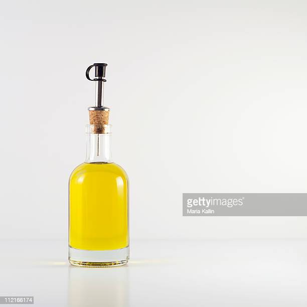 olive oil in glass bottle - olive oil stock pictures, royalty-free photos & images