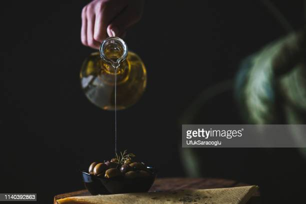 olive oil - extra virgin olive oil stock pictures, royalty-free photos & images