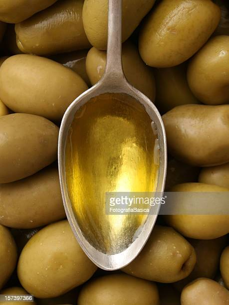 olive oil - green olive stock photos and pictures