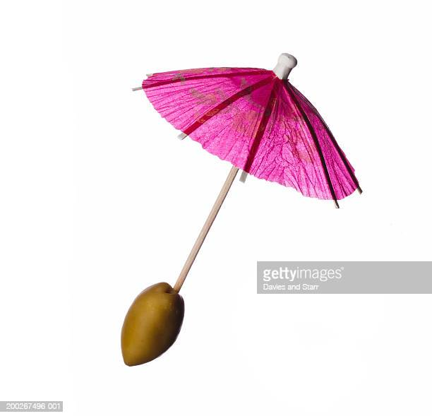 Olive on cocktail stirrer umbrella