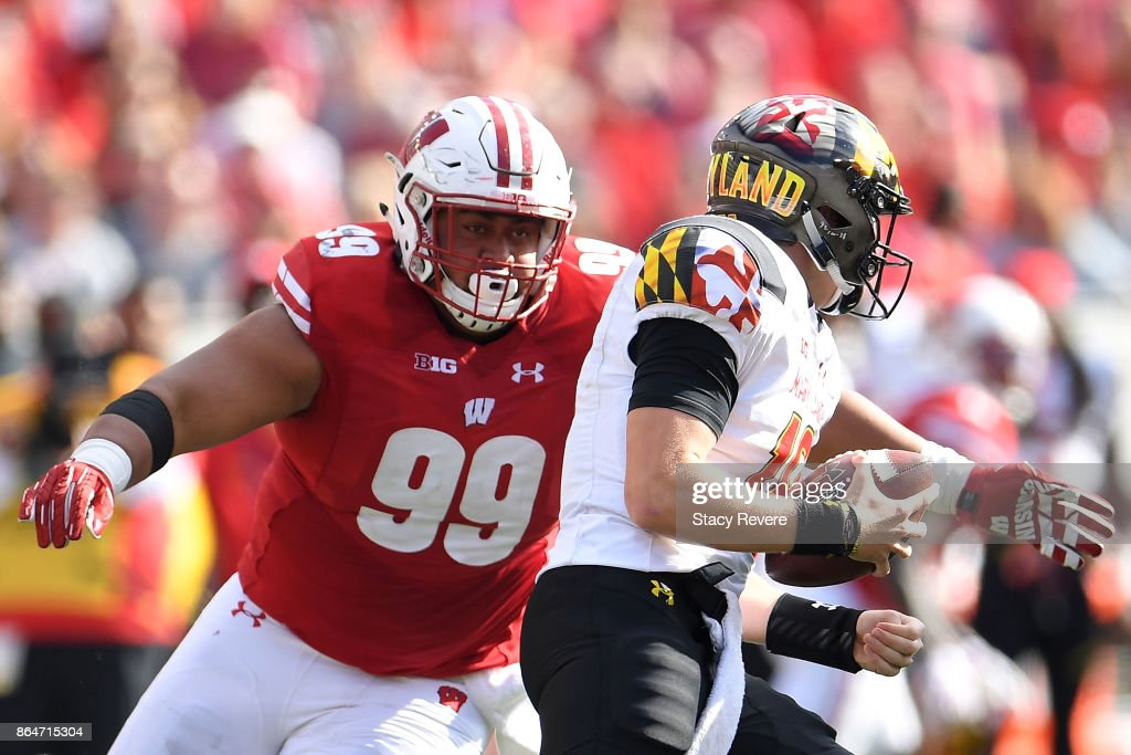 Olive Sagapolu #99 of the Wisconsin Badgers pressures Max Bortenschlager #18 of the Maryland Terrapins during the second half at Camp Randall Stadium on October 21, 2017 in Madison, Wisconsin.
