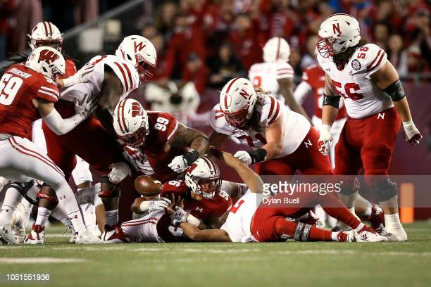 Olive Sagapolu of the Wisconsin Badgers recovers a fumble in the third quarter against the Nebraska Cornhuskers at Camp Randall Stadium on October 6...