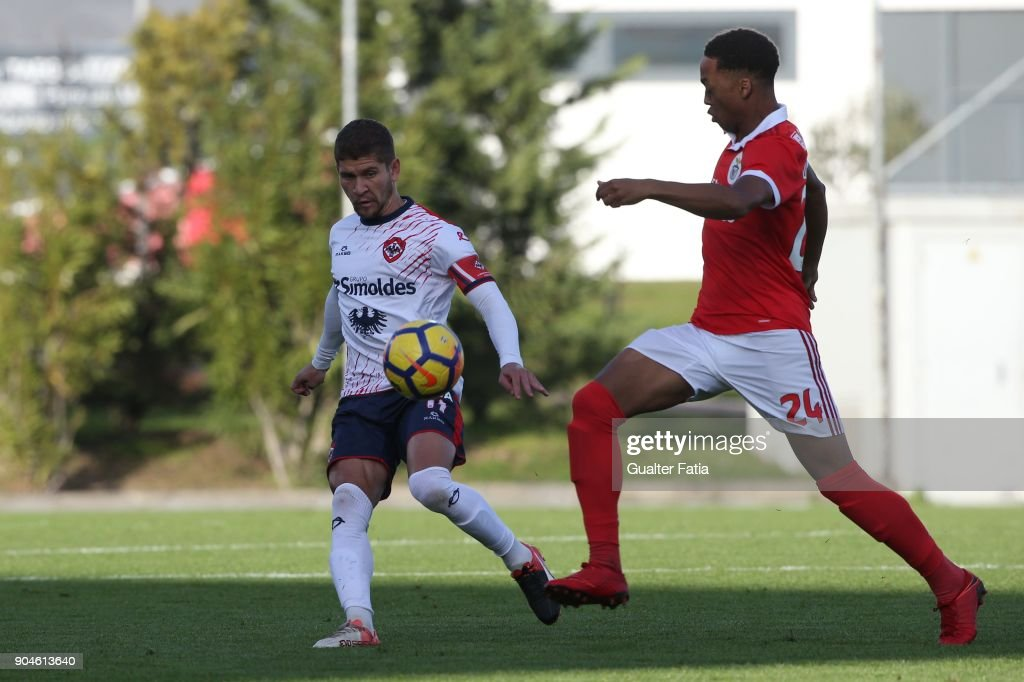 UD Oliveirense defender Alemao from Brazil with SL Benfica forward Chris Willock from England in action during the Segunda Liga match between SL Benfica B and UD Oliveirense at Caixa Futebol Campus on January 13, 2018 in Seixal, Portugal.