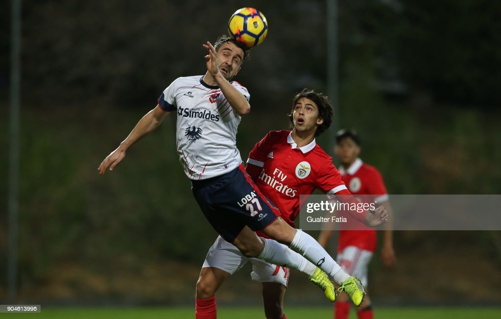 UD Oliveirense forward Diogo Valente from Portugal with SL Benfica midfielder Joao Felix from Portugal in action during the Segunda Liga match between SL Benfica B and UD Oliveirense at Caixa Futebol Campus on January 13, 2018 in Seixal, Portugal.