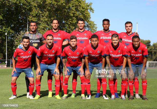 Oliveirense players pose for a team photo before the start of the Portuguese League Cup 2nd Round match between CF Os Belenenses and UD Oliveirense...