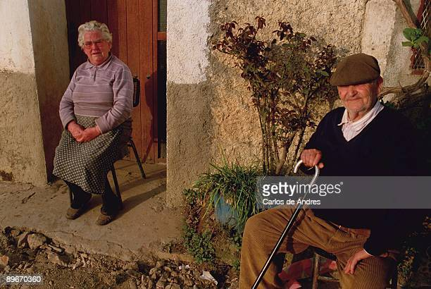Olivenza Badajoz A couple of pensioners sunbathing at home´s door