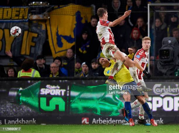 Oliver Abildgaard of AaB Aalborg and Dominik Kaiser of Brondby IF compete for the ball during the Danish Superliga match between Brondby IF and AaB...