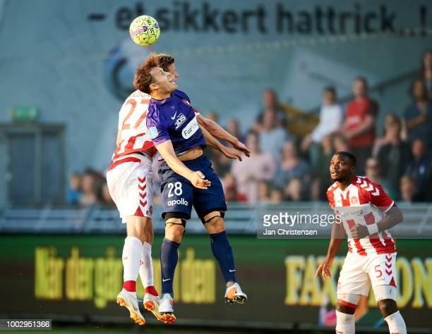 Oliver Abildgaard of AaB Aalborg and Erik Sviatchenko of FC Midtjylland heading the ball during the Danish Superliga match between AaB Aalborg and FC...