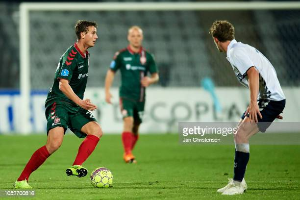 Oliver Abildgaard of AaB Aalborg controls the ball during the Danish Superliga match between AGF Arhus and AaB Aalborg at Ceres Park on October 21...
