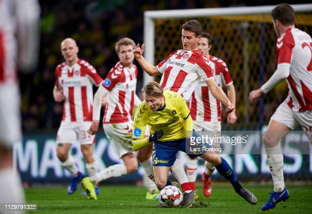 Oliver Abildgaard of AaB Aalborg making a penalty in Simon Hedlund of Brondby IF during the Danish Superliga match between Brondby IF and AaB Aalborg...