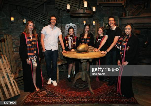 Oliver and James Phelps pose alongside school children at the Powerhouse Museum on November 17 2011 in Sydney Australia