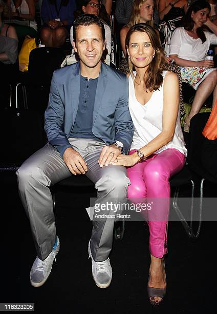 Oliver and Klara Bierhoff sit in front row at the Strenesse Blue Show during MercedesBenz Fashion Week Berlin Spring/Summer 2012 at the Brandenburg...