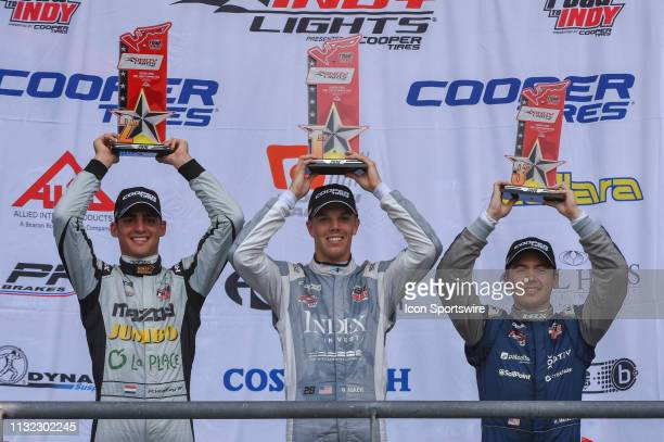 Oliver Askew of Andretti Autosport center Robert Megennis of Andretti Autosport left and Rinus VeeKay of Juncos Racing right hold their trophies for...