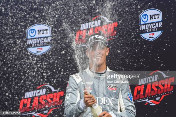 Oliver Askew of Andretti Autosport sprays champagne to celebrate winning the IndyCar Lights afternoon qualifications at Circuit of the Americas on...