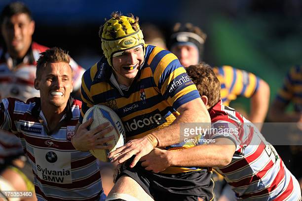 Oliver Atkins of Southern Districts runs with the ball during the round 16 Shute Shield match between Sydney Uni and Southern Districts at North...