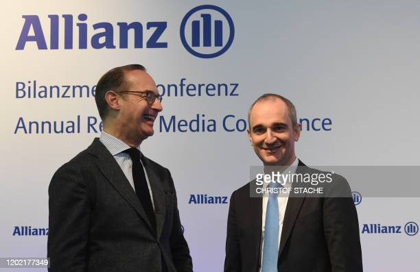 Oliver Baete , CEO of German insurance group Allianz, and Allianz CFO Giulio Terzariol, pose prior to the company's annual results press conference...