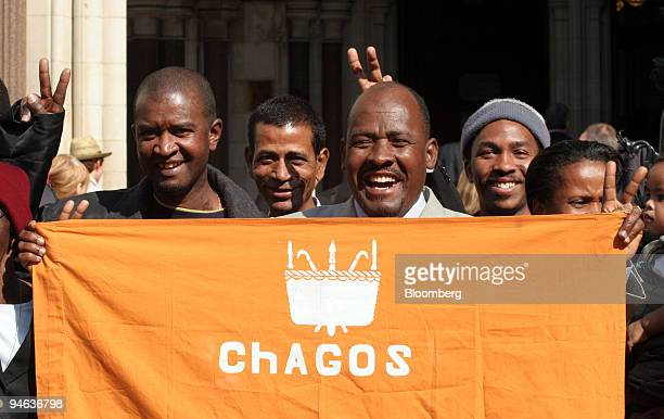Oliver Bancoult center right celebrates with other Chagos islanders at the High Court in London Thursday May 11 2006 Natives of the Indian Ocean...