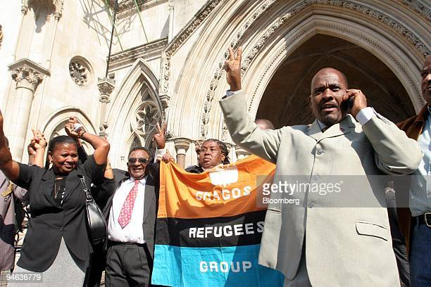 Oliver Bancoult right celebrates with other Chagos islanders at the High Court in London Thursday May 11 2006 Natives of the Indian Ocean island of...