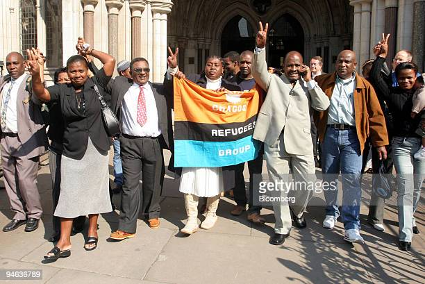 Oliver Bancoult third right celebrates with other Chagos islanders at the High Court in London Thursday May 11 2006 Natives of the Indian Ocean...