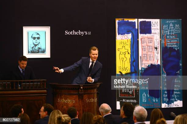 Oliver Barker SothebyÕs European Chairman fields bids for Andy WarholÕs ÔSelf PortraitÕ from 196364 during the Contemporary Art Evening Auction at...