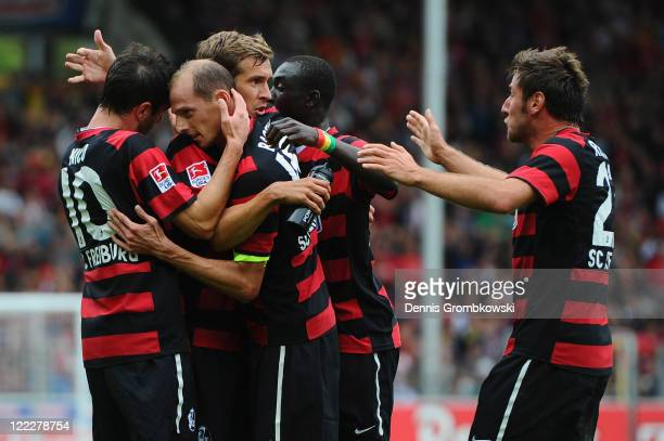 Oliver Barth of Freiburg celebrates with team mates after scoring his team's opening goal during the Bundesliga match between SC Freiburg and VfL...