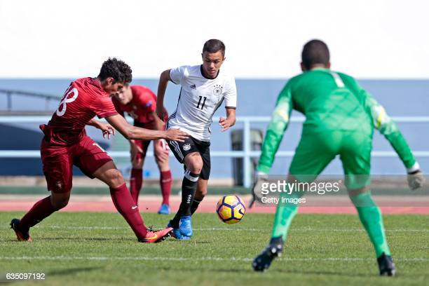 Oliver BatistaMeier of Germany U16 challenges Rodrigo Feranndes and João Monteiro of Portugal U16 during the UEFA Development Tournament Match...