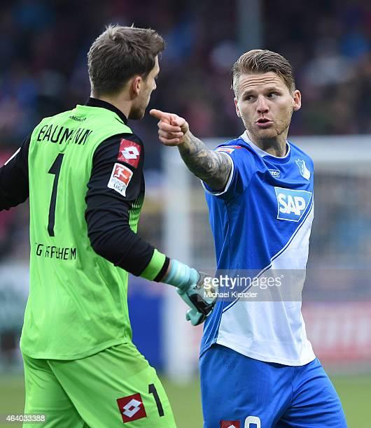 Oliver Baumann and Eugen Polanski of 1899 Hoffenheim discuss during the Bundesliga match between SC Freiburg and 1899 Hoffenheim at...