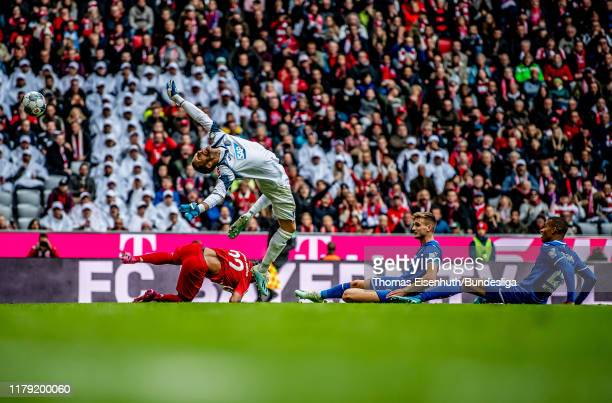 Oliver Baumann of Hoffenheim cannot save the shot by Serge Gnabry of Munich during the Bundesliga match between FC Bayern Muenchen and TSG 1899...