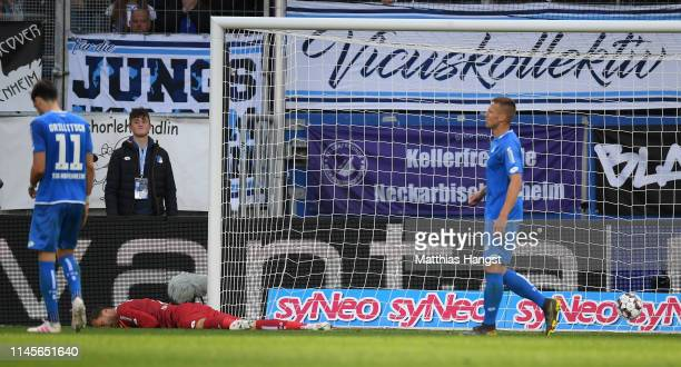 Oliver Baumann of Hoffenheim lays on tne pitch after he misjudges the bounce of the ball leading to Wolfsburg scoring their second goal during the...