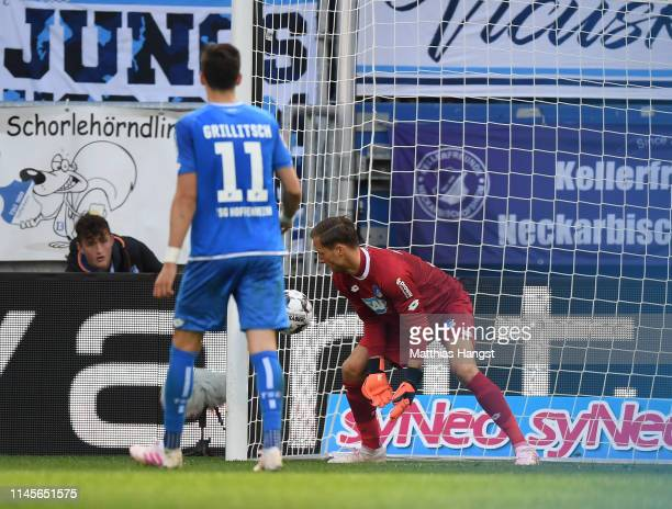 Oliver Baumann of Hoffenheim misjudges the bounce of the ball as Wolfsburg score their second goal during the Bundesliga match between TSG 1899...
